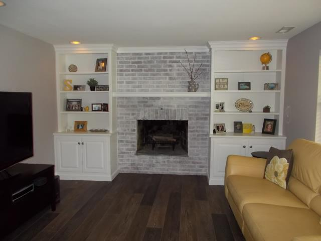 Haddonfield, NJ - Custom built in cabinets, new mantle, cork backed plank flooring, and a whitewashed fireplace transformed this living room into a dynamic space for our Haddonfield project !