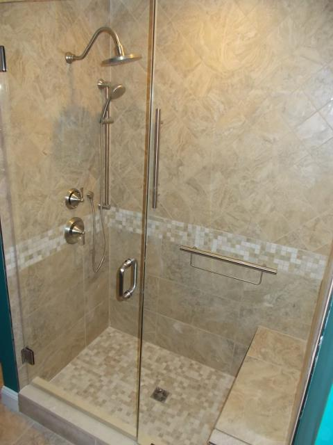 Medford, NJ - Beautiful new shower in one of our Medford bathroom projects.  Frameless shower glass, bench, and Moen Wynford fixtures in brushed nickel.