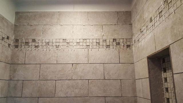 Eastampton Township, NJ - The tile in our Eastampton shower remodel has begun.  Great work from the Nuss team.  The murano glass mosaic band and niche detail is an attractive touch !