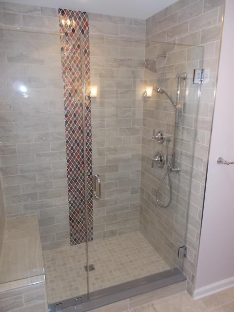 Medford, NJ - Medford bathroom project is complete with beautiful tiled shower, Moen fixtures, bench and frameless glass door.