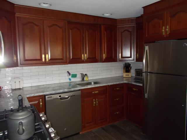 Haddonfield, NJ - Haddonfield kitchen remodel is complete, new subway tile back-splash, the look of carrara on the counter-tops, new appliances sink and lighting transformed this space beautifully !