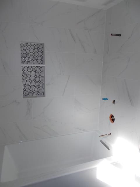 Marlton, NJ - In our Marlton bathroom, the tilework is bringing this shower/tub alcove to life with a mosaic niche and carrara look on the walls.
