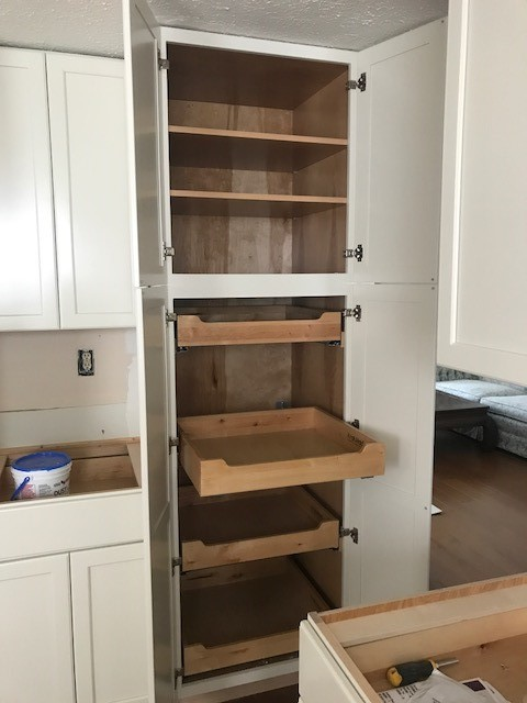 Evesham Township, NJ - Our Marlton kitchen is progressing nicely ! We demolished a tiny pantry closet and replaced it with this full height cabinet that has adjustable shelves on the top, and full extension rollouts on the bottom !
