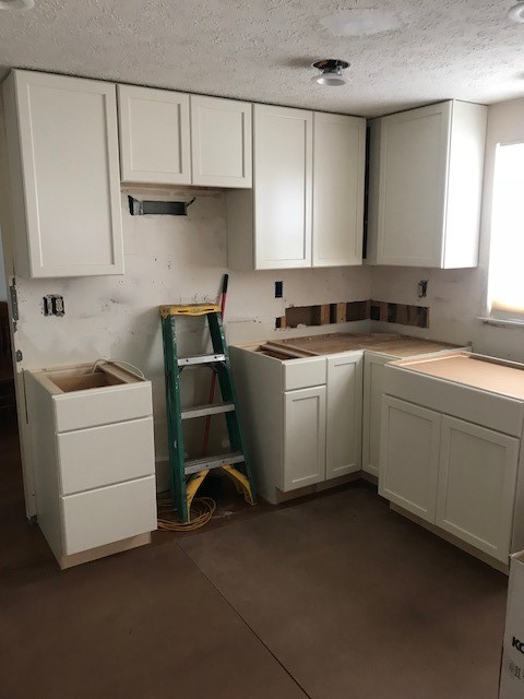 Evesham Township, NJ - New cabinets are being set at our Marlton kitchen job.  Today we template the granite countertops.  Check back for more updates and to see the gorgeous new floors we're installing.