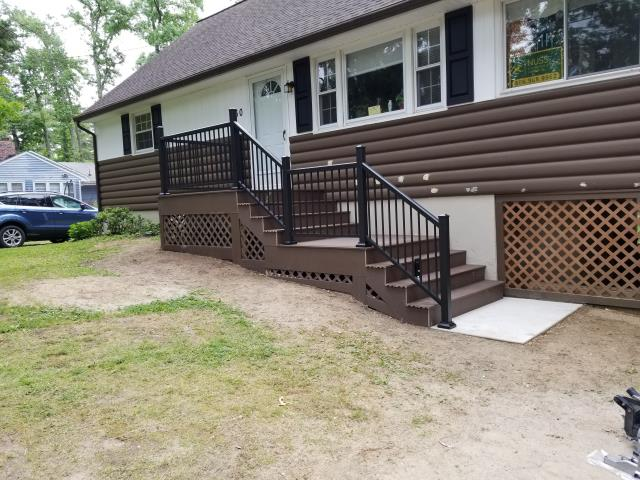 Medford Lakes, NJ - Our Medford Lakes front porch and steps job is almost fully complete and what a transformation ! We still need to install the graspable hand rail and touch up the log siding.  The Timber Tech decking and aluminum rail look fantastic on this half log beautiful home.