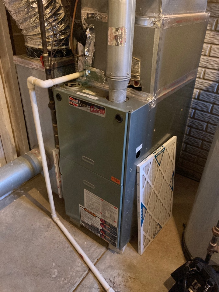 Completing maintenance on a Ruud gas furnace