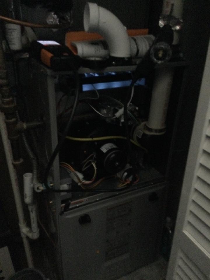 Performing maintenance on a 2020 comfortmaker gas furnace.