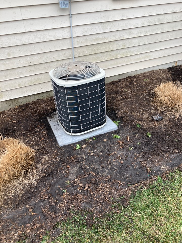 Performing maintenance on a a Bryant air conditioner