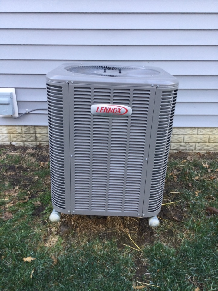 Annual maintenance check on a Lennox air conditioner