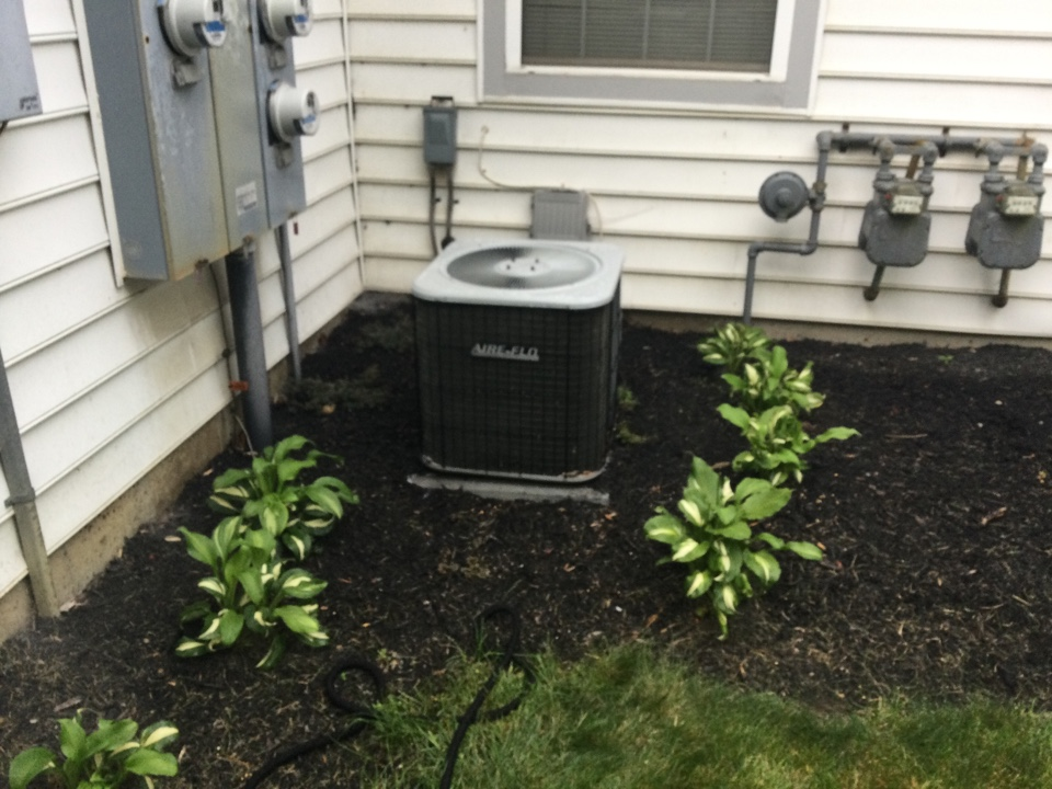 Performing maintenance on a 2010 Lennox air conditioner.