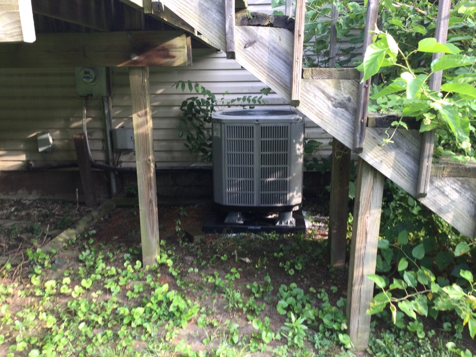 Performing maintenance on a 2020 American standard air conditioner.