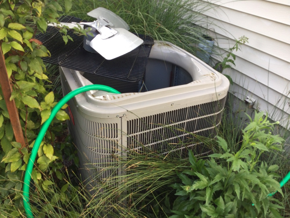 Performing maintenance on a 2014 Bryant t air conditioner.