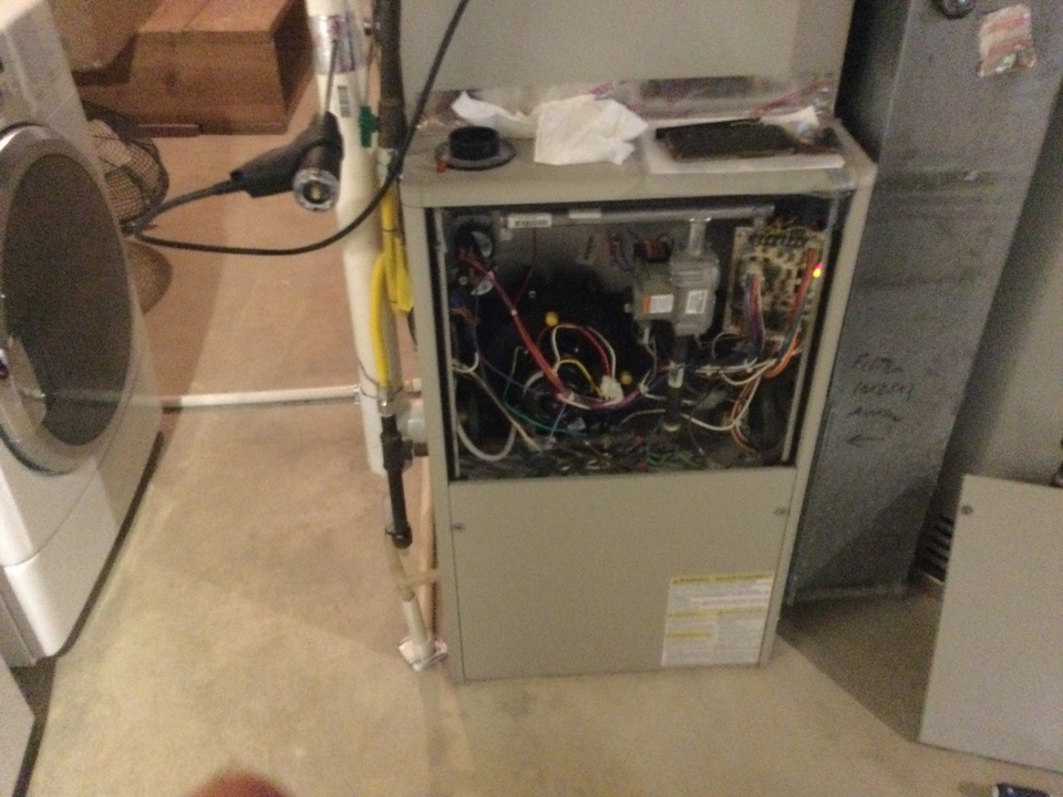 Performing maintenance on a. 2004 high efficiency gas furnace.