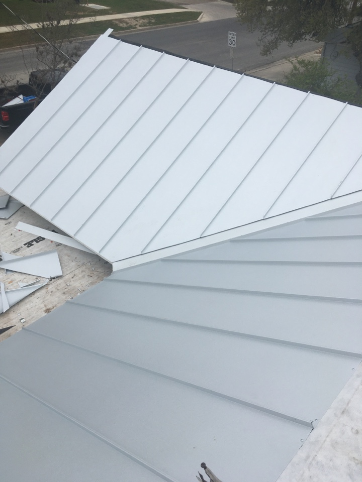 Seguin, TX - We are done re-decking and installing synthetic underlayment we are now installing the flat standing seam double lock roofing system we are installing panels