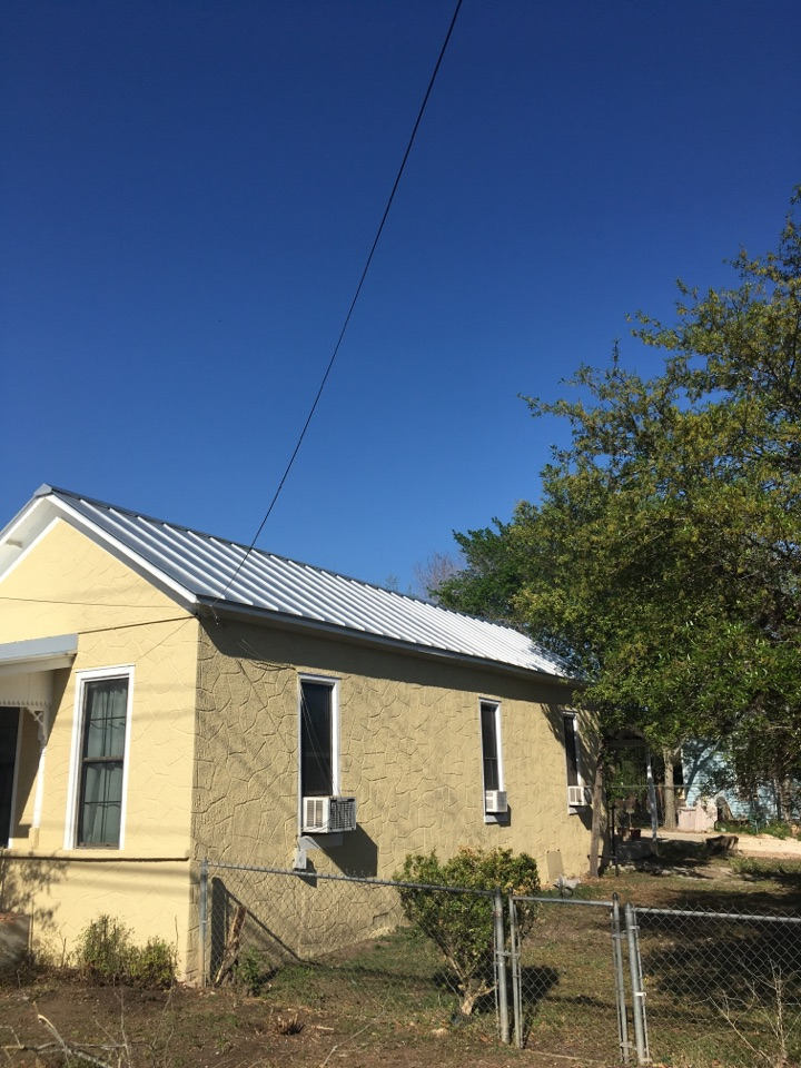 Seguin, TX - Roof replacement with standing seam metal the job has been completed here are the after pictures . We are going to  add galvanized seamless gutters .