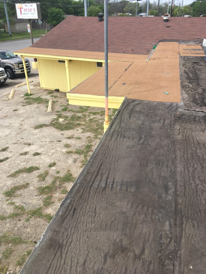 San Antonio, TX - We are doing the final measurements for this roof replacement we are going to tear off those three ply torch down in about 20 squares of three tab shingles were going to replace it with lifetime duration shingles and we're also going to replace all the flat roof about 45 squares with Tpo the best commercial flat roofing