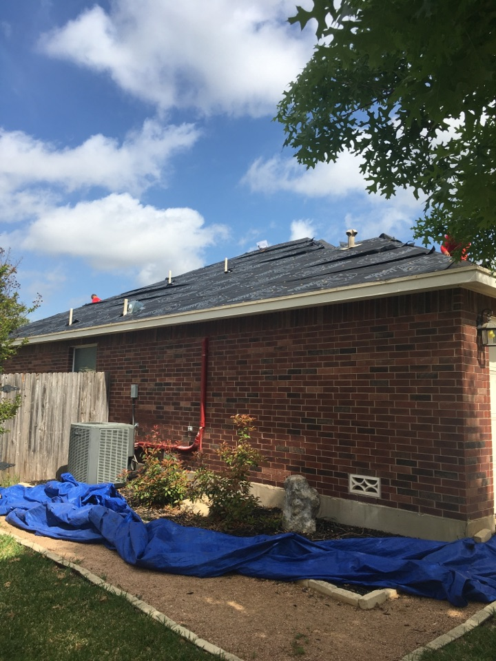 San Antonio, TX - We are removing three tab shingles and replacing it with synthetic underlayment ice and water shield in the valleys and were using a true definition duration Owens Corning shingle we are also replacing some plywood that is rotted