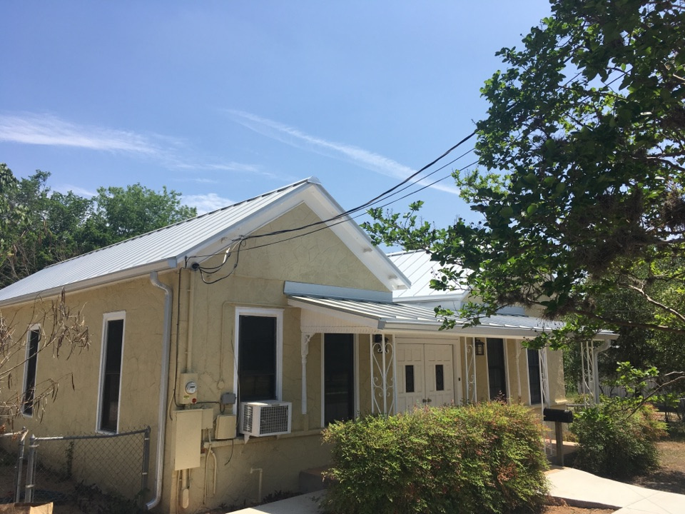 """Seguin, TX - This is the completed project of the removal and replacement of the standing seam 24 gauge Galvilum with a 1 inch Standing seam , we installed seamless gutters as well the color galvilum to match the roof with downspouts . We installed a new deck as well on the roof with 1/2 """" plywood ."""