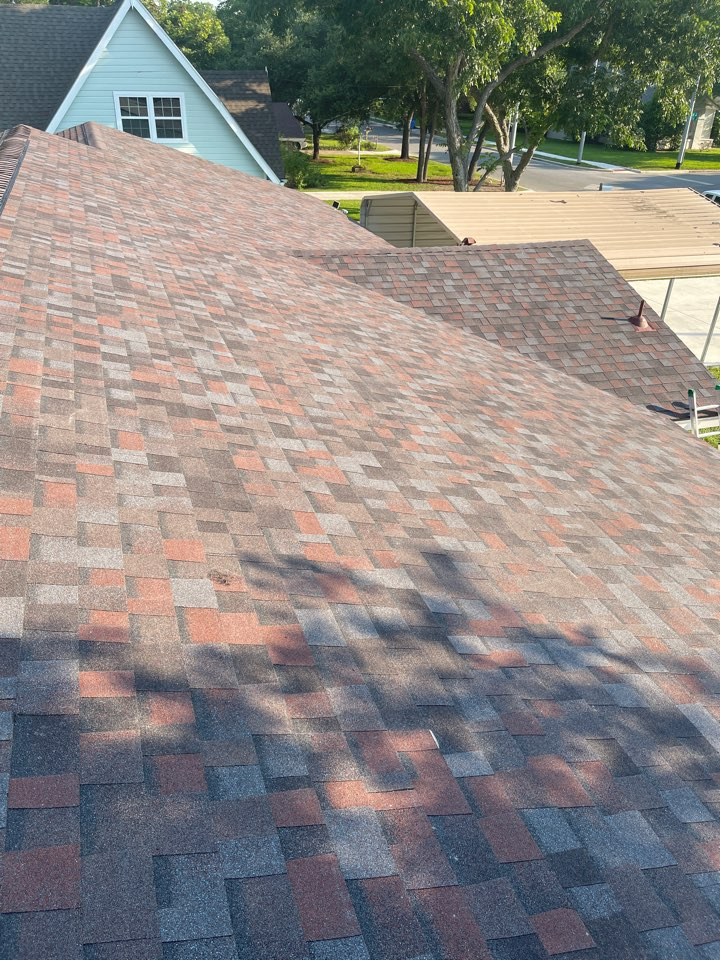 Seguin, TX - Tore off three tab shingles we replaced it with an architectural true definition duration the color Merlot added ridge vent high profile ridge cap