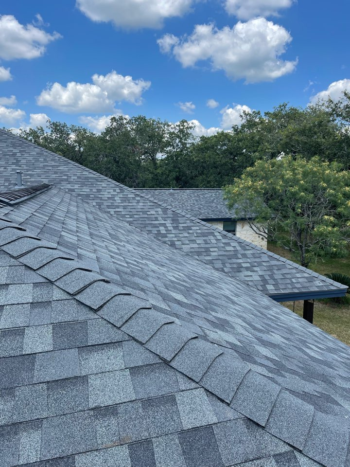 Stockdale, TX - Remove three tab shingles replaced the true definition duration Owens corning the color estate gray with high profile ridge cap we also added ridge vent
