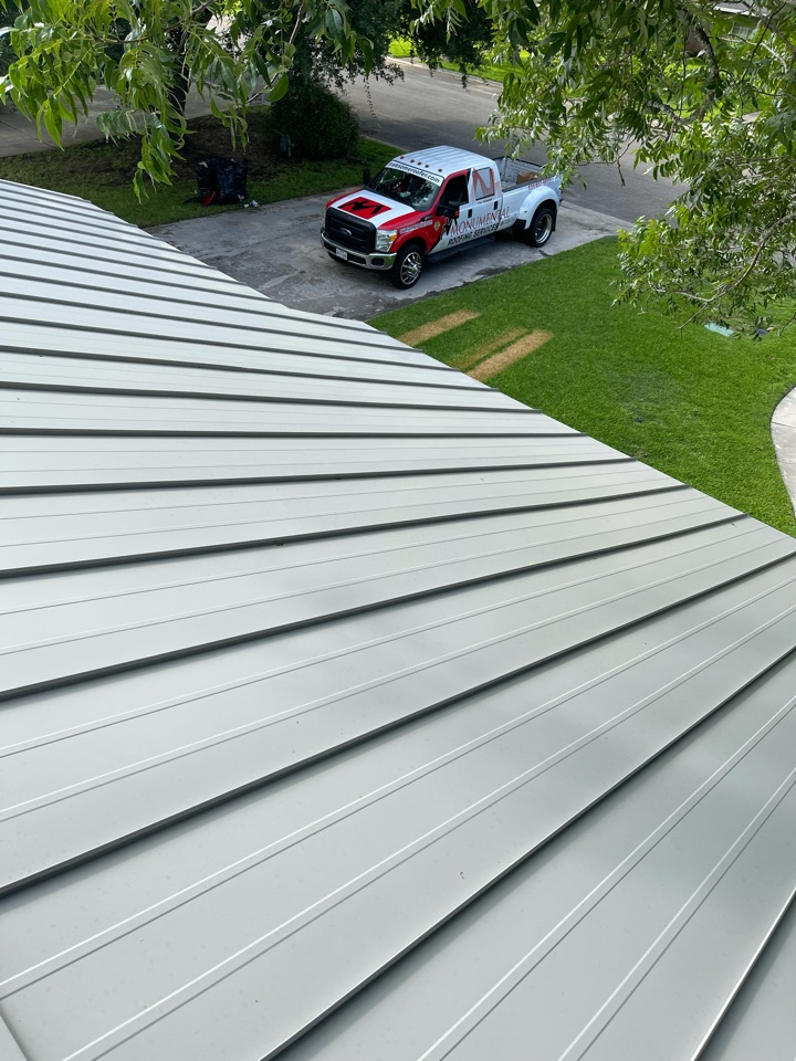 Hondo, TX - These are after photos of the standing seam metal roof and Hondo Texas we replace the shingle roof with standing seam 24 gauge double lock metal roof the color is ash gray