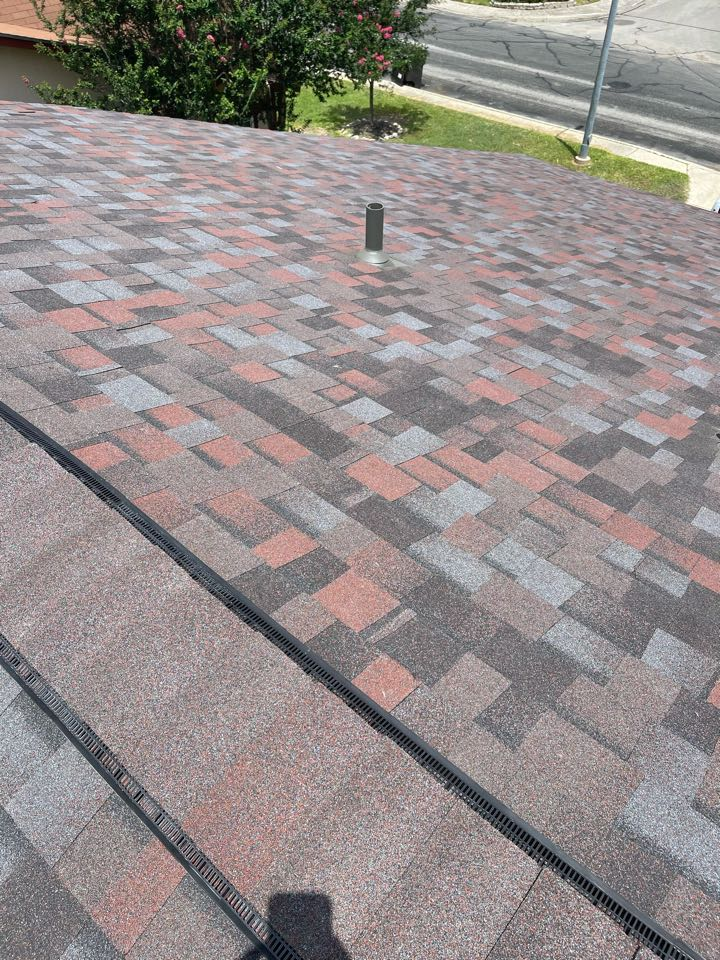 San Antonio, TX - After photos of a roof replacement, we removed three tab shingles and install synthetic underlayment true definition Duration lifetime warranty shingles we upgraded to ridge vent as well