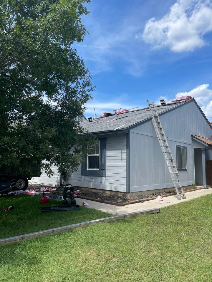 San Antonio, TX - We are demoing the back patio cover we are removing the shingles we are replacing it with true definition Duration by Owens corning and we're also upgrading to ridge vent as well