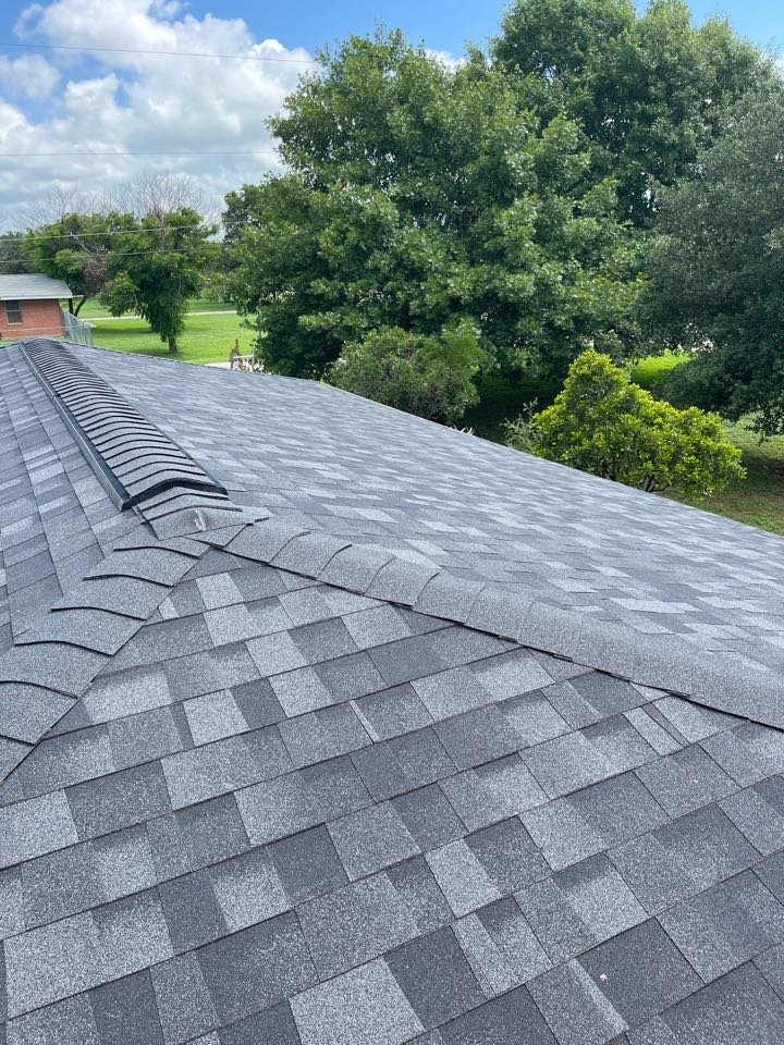 San Antonio, TX - Roof replacement in China Grove Texas onyx black duration shingles with a razor ridge cap and ridge vent added we did all the gutters as well