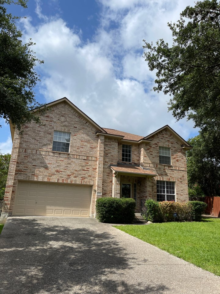 San Antonio, TX - Removed and replaced three tab shingles for the true definition duration desert tan we added high profile rizor ridge cap added ridge vent and we're going to add gutters in the front
