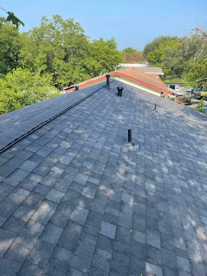 San Antonio, TX - After pictures of a roof replacement done in San Antonio Texas we remove the old three tab shingles that I had hail damage we upgraded to a true definition duration onyx black by Owens corning high profile rizor Ridge cap, Ridge vent