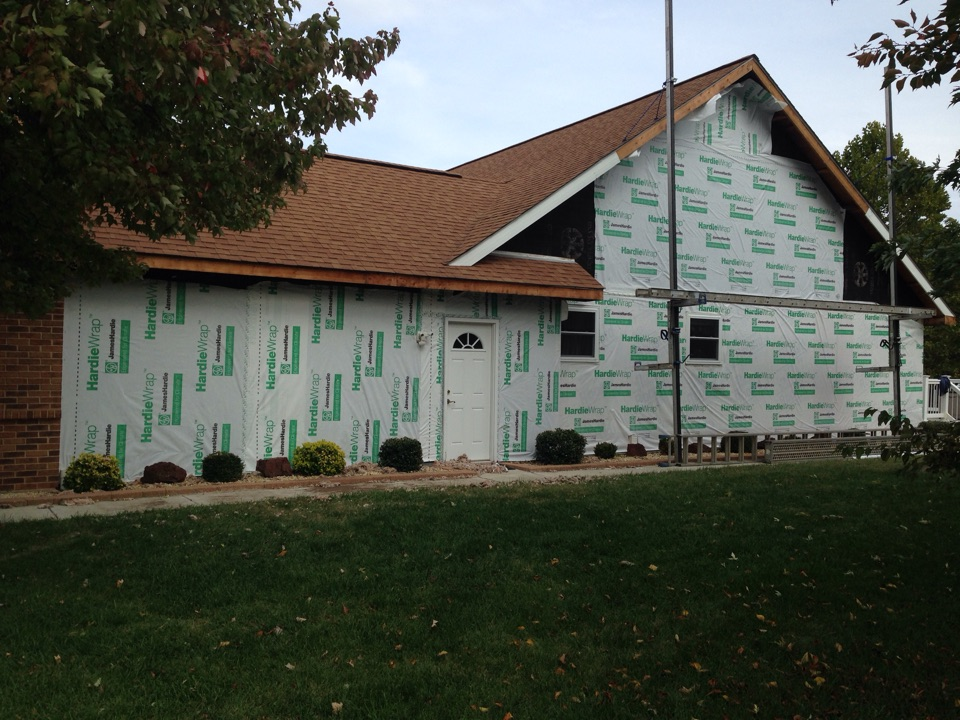 St. Charles, MO - Peparring a house for new siding.  Removed old vinyl siding and installed James Hardie Weather resistant barrier and will be installing insulated vinyl siding.