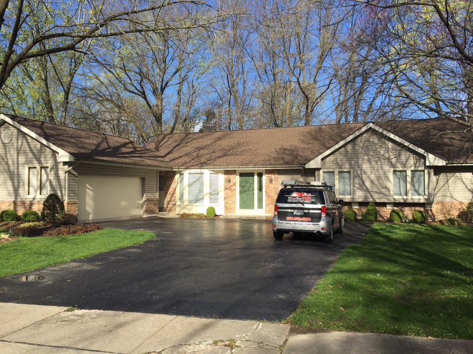 Chesterfield, MO - Another beautiful lifetime roofing system by XteriorPRO.  GAF Architectural shingle in Weatheredwood color.