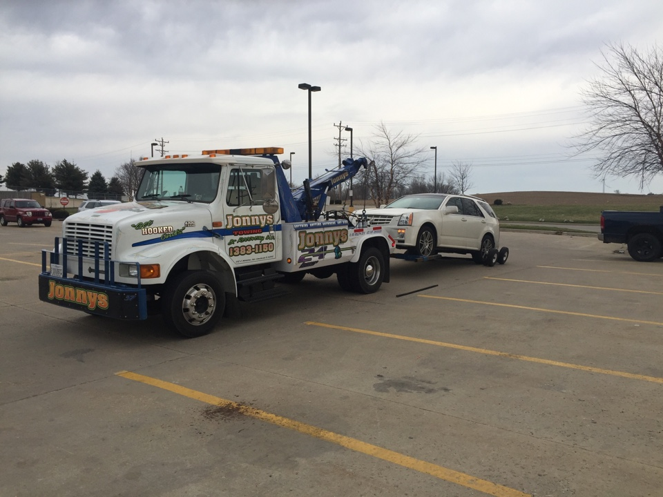 Monroe Center, IL - Towing service with dollies Cadillac from i39 exit for Byron il