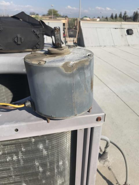Our Tulare area commercial AC technician returned to a vitamin store to complete approved work. Installed a new condenser fan motor, blade and capacitor on their Carrier package system. Tested and cycled unit after making repairs. System up and running well again.