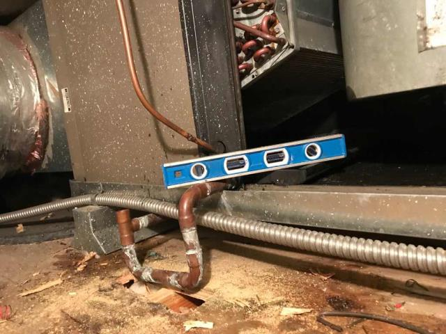 Responded to an emergency water leak call at a paint store in Culver City CA. Our commercial HVAC technician found the #1 air handler with a clogged p-trap, causing the leak. Cleared and cleaned pan and drain line. Noted that there was still water sitting in the pan due to improper leveling of the pan. Used truck stock to adjust level on pan and slope for P-trap to ensure proper drainage. Tested with water, unit draining correctly. *Note: Also found unit #2 off, unrelated to water leak. Breaker was off, reset and tested, found no issues. Working normally now.