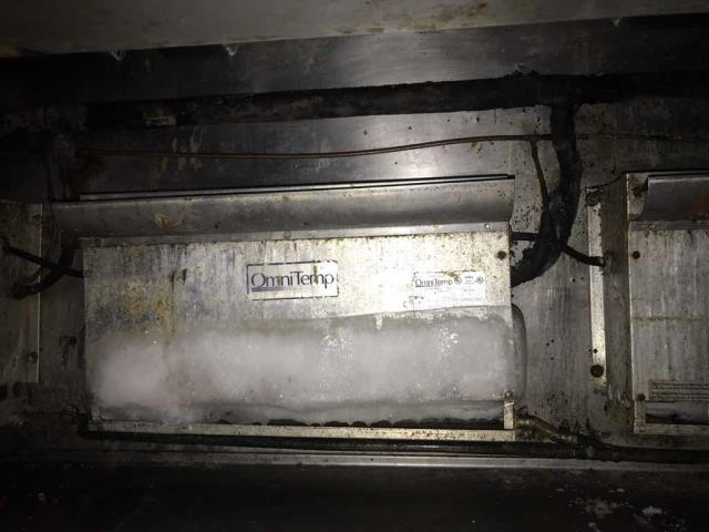 Anaheim, CA - A restaurant in Anaheim California requested service. Their expo table had two fans that were frozen over solid with ice. Our technician troubleshooted the system, finding the suction pressure dropping. Noted that the line-set is incorrectly sized at the discharge line, and the defrost clock was set for 6 hours at night without any during the day, and that it was wired incorrectly to not shut down the compressor. Will  need to source necessary parts and quote to repair.