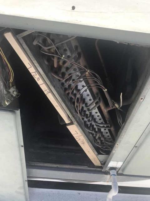 A commercial customer in Arleta California reported that their AC was only blowing hot air. Upon arrival, our technician inspected both systems and found the Rheem air conditioner low on refrigerant with a failed condenser fan motor. Also found the #2 Trane unit with a pitted contactor. Quoting necessary repairs, unit #2 operational only.