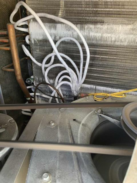 Dispatched our Turlock CA area AC tech to a home goods store with an office unit not working. After checking in with the vendor log and store manager, our tech gained roof access. Found RTU 6 low on refrigerant charge, confirmed that a full leak search will need to be completed. Also inspected unit #5 while onsite, found that the smoke alarm was going off due to a failed disconnect. Bypassed the disconnect temporarily, tagging and marking system. Will need to quote replacement of #5's disconnect.