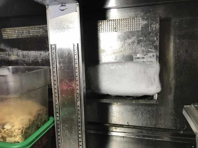 A restaurant in Dublin, California, reported their AC unit leaking, and the sandwich counter not holding temperature. Our commercial technician found the second evaporator coil frozen, and the rooftop section with clogged filters and a worn belt. This situation was causing the water leak. He was able to defrost the evaporator and clear a clog from the drain line. Unit is operating partially, will need to quote additional repairs.