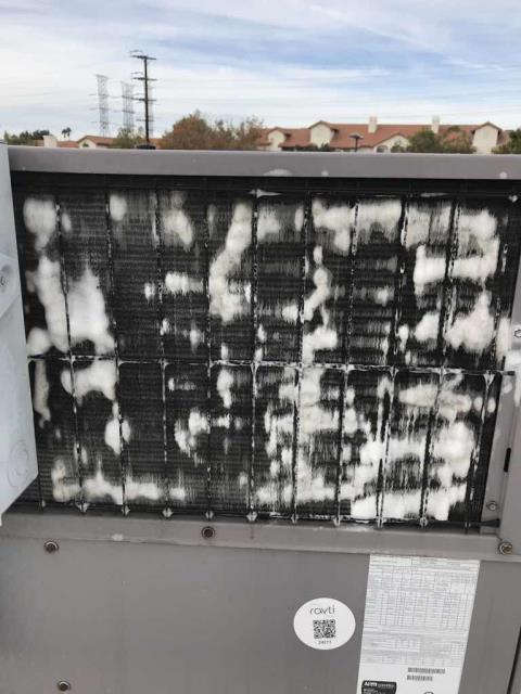 Los Angeles, CA - A health center in Granada Hills, CA, was scheduled for approved A/C repairs today. Our technician replaced the economizer screen on their commercial ICP unit, and wash all rooftop condenser coils for all units. Units working well after repairs, job complete.