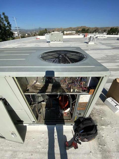 Approved HVAC repairs were scheduled today at a medical center in Santa Clarita, CA. Our technician brought the ordered parts and powered down the commercial unit, removing the old motor and capacitor. After wiring in the replacement parts, he powered up the system to test operations. Unit now working properly and cooling. No more issues to report.
