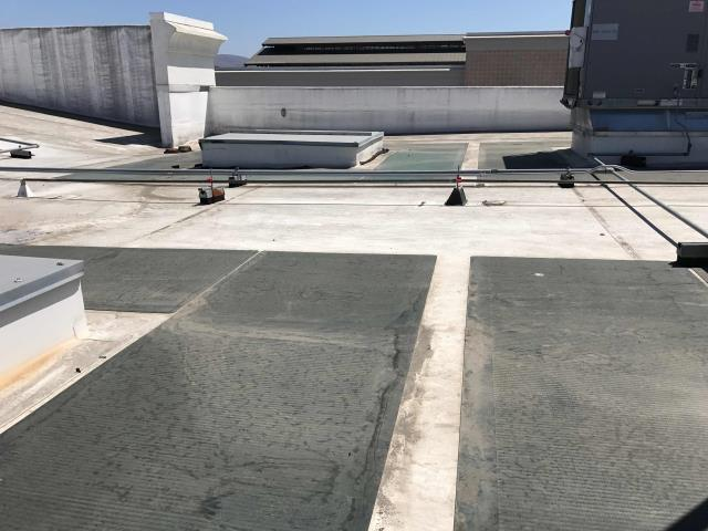 Chula Vista, CA - Jewelry store at Otay Ranch Town Center in Chula Vista reporting a water leak in ceiling near lighting. Inspected roof and found drain lines not sloped properly causing water to back up. Adjusted blocks on roof so drain lines would flow properly.