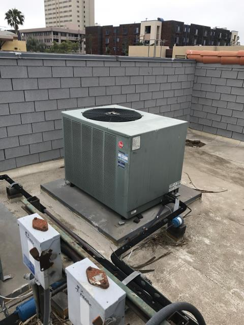 Santa Monica, CA - RESSAC  A/C technician arrived at retail store in Santa Monica, California to defrost an ADP HVAC unit with iced up condenser coils. Tech defrosted the unit and reset the times and schedules of operation on the units so that they were not operating while the store was closed to save power and slow down unit degradation. Tech tested the unit and made sure it was running optimally.