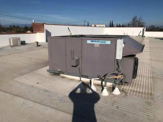 Fresno, CA - HVAC tech was dispatched to drug store in Fresno, California to repair two Carrier air conditioners that were not cooling. He found that one of the units had a refrigeration leak and the other one had a faulty control board. Tech received a new control board and replaced the faulty board.  Unit was restored to working condition. On the other package unit, he repaired the system leak and recharged the system. This unit was also repaired to full operation.