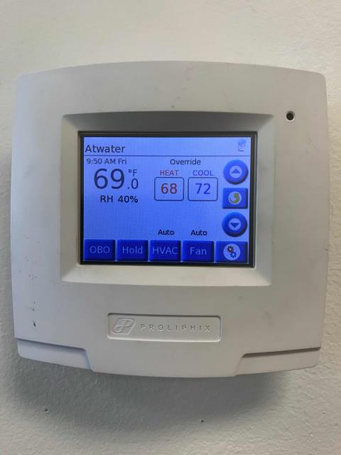 Atwater, CA - Commercial Controls technician arrived at office in Atwater, California to install a new manual thermostat. He installed the thermostat and reprogrammed to the client's request.