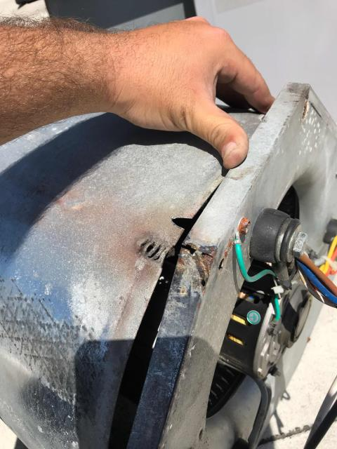 Santa Ana, CA - RESSAC HVAC tech arrived at a healthcare provider in Santa Ana, California, to inspect an air conditioner making loud noises. Traced the problem to an ICP unit down with a damaged blower housing. Tech shut down unit for safety, noted issues for quoting repairs to customer.