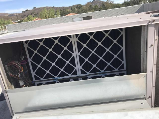 Westlake Village CA, home goods store requested carbon filters be installed due to nearby fires. Tech removed old and installed new filters, cycled units to confirm air conditioners were all running normally.