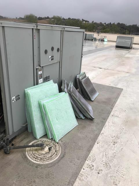 Home goods store in Corona, CA, was due for routine HVAC maintenance. Technician inspected all components for cooling season, changed filters and belts, took photos and recorded issues with the #2 Lennox air conditioner. #2 had two pitted compressor contactors. Other units working well.