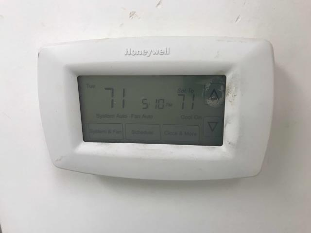 Pittsburg California grocery store had an upstairs office with no cooling. AC tech found the thermostat programmed incorrectly. Reprogrammed for the correct days, confirmed electrical connections were OK.