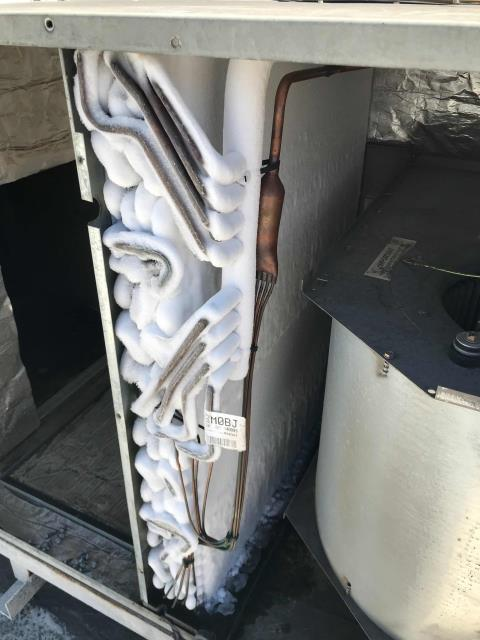 Fresno, CA - Fresno CA area technician dispatched to a cash advance shop for the AC not cooling. Tech found the American Standard air conditioner off, unit iced over over due to a failed blower motor and bearings. Will quote the motor, bearings and a bad capacitor to the customer. Leaving unit off to defrost as we quote for repairs.